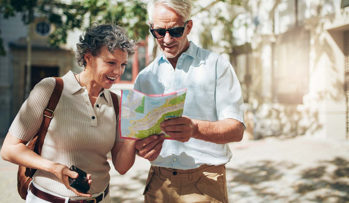 bigstock-Senior-Couple-Reading-A-Touris-138316946